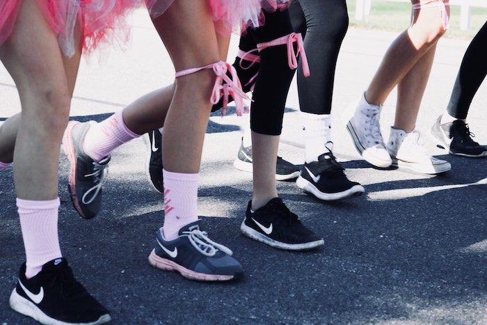 breast cancer awareness month | south coast medical group | race runners starting line