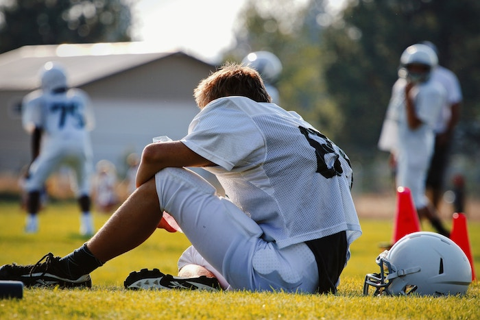 concussion | head injury | South Coast Medical Group | injured football player | young athlete